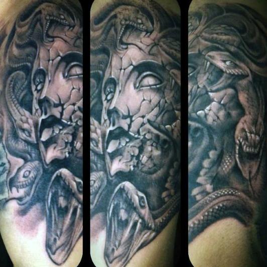 man-with-greek-art-tattoo