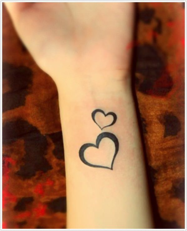Small heart tattoos on wrist