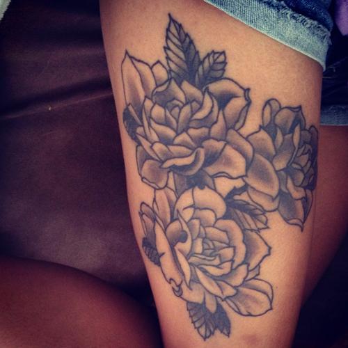 Stimulating Thigh Tattoos 18