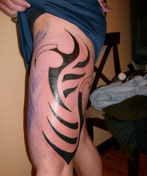 Stimulating Thigh Tattoos 26