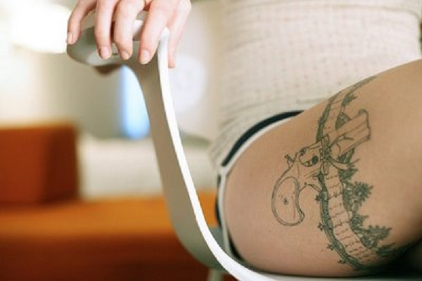Stimulating Thigh Tattoos 31