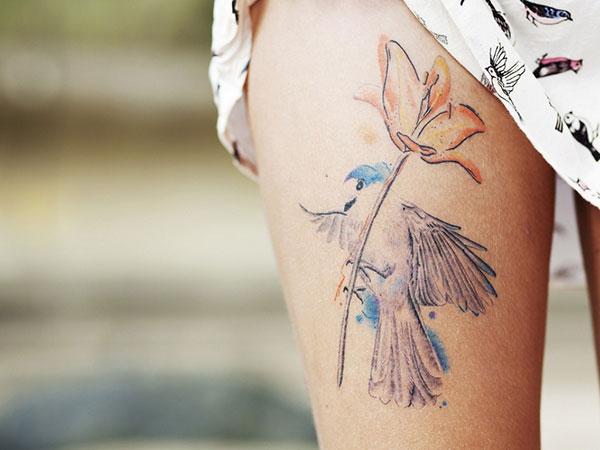 Stimulating Thigh Tattoos 36