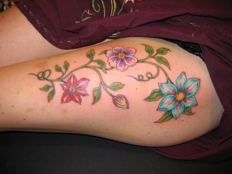 Stimulating Thigh Tattoos 43