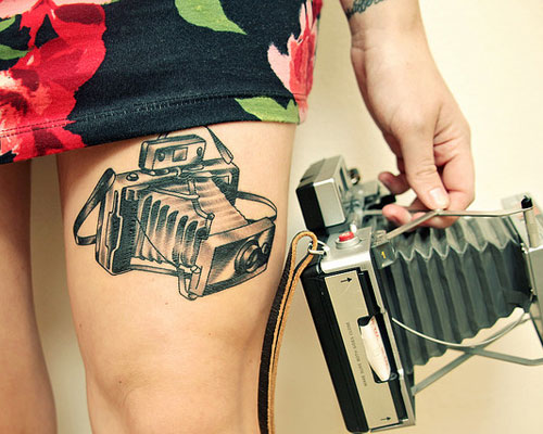 Stimulating Thigh Tattoos 44