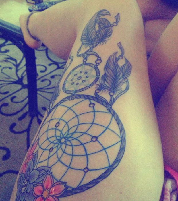 Stimulating Thigh Tattoos 45